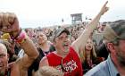 <p>Bryan Watkins of Cushing reacts to a performance by Seether during Rocklahoma in 2014. JOHN CLANTON/Tulsa World</p>