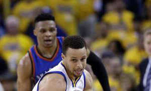 Golden State Warriors' Stephen Curry (30) dribbles down court against the Oklahoma City Thunder during the second half in Game 5 of the NBA basketball Western Conference finals Thursday, May 26, 2016, in Oakland, Calif. Golden State won 120-111. (AP Photo/Marcio Jose Sanchez)