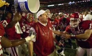 NATIONAL CHAMPIONSHIP, COLLEGE FOOTBALL: OU coach Bob Stoops reacts after getting drenched by his players after the Sooners beat Florida State 13-2 in the Orange Bowl Wednesday, Jan. 3, 2001 at Pro Player Stadium in Miami, Fla. (AP Photo/David F. Martin)