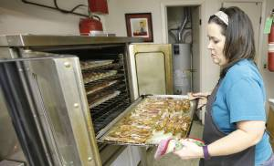 Cher Brown removes bacon from the oven in preparation for the German Feast and Auction at Corn Bible Academy in Corn. [Photo By Steve Gooch, The Oklahoman]