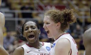 Oklahoma's Sharane Campbell, left, and Joanna McFarland celebrate during the second half of a first-round game against Central Michigan in the women's NCAA college basketball tournament Saturday, March 23, 2013, in Columbus, Ohio. Oklahoma beat Central Michigan 78-73. (AP Photo/Jay LaPrete) ORG XMIT: OHJL109
