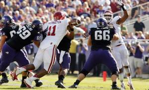 Oklahoma's R.J. Washington (11) forces a fumble by Trevone Boykin (2) during the second half of the college football game where the University of Oklahoma Sooners (OU) defeated the Texas Christian University Horned Frogs (TCU) 24-17 at Amon G. Carter Stadium in Fort Worth, Texas, on Saturday, Dec. 1, 2012. Photo by Steve Sisney, The Oklahoman