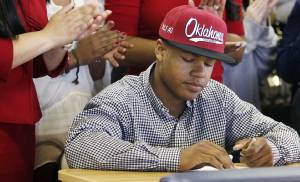 Heritage Hall's Sterling Shepard signs to play football for the University of Oklahoma as family members applaud during the National Signing Day ceremony at Heritage Hall in Oklahoma City, Wednesday, Feb. 1, 2012. Photo by Nate Billings, The Oklahoman  NATE BILLINGS