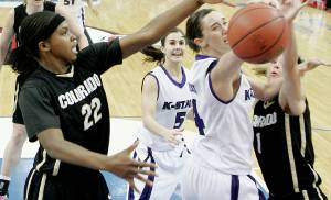 Kansas State's Ashley Sweat fights for the ball between Colorado's Brittany Spears, left, and Alyssa Fressie as Shalee Lehning watches during the Big 12 Women's Championship game between Kansas State and Colorado at the Cox Center in Oklahoma City, Thursday, March 12, 2009.  PHOTO BY BRYAN TERRY, THE OKLAHOMAN ORG XMIT: KOD