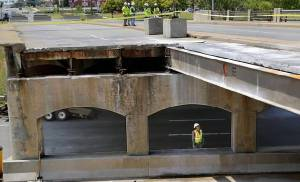 Beams like the three that must be replaced were exposed after debris from the partial collapse of the May Avenue bridge at Northwest Expressway was removed last weekend. [Photo by Jim Beckel, The Oklahoman]