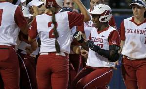 Oklahoma's Shay Knighten (17) is greeted at home by her teammates after hitting a home run in the fifth inning of a Bedlam softball game between the University of Oklahoma (OU) Sooners and the Oklahoma State University (OSU) Cowgirls at ASA Hall of Fame Stadium in Oklahoma City, Wednesday, March 30, 2016. Photo by Bryan Terry, The Oklahoman