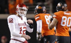 Oklahoma's Landry Jones (12) walks off the field after being stopped on a drive during the Bedlam college football game between the Oklahoma State University Cowboys (OSU) and the University of Oklahoma Sooners (OU) at Boone Pickens Stadium in Stillwater, Okla., Saturday, Dec. 3, 2011. Photo by Chris Landsberger, The Oklahoman