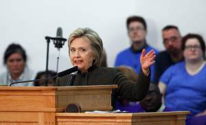 Democratic presidential candidate Hillary Clinton speaks Sunday at the House Of Prayer Missionary Baptist Church in Flint, Mich. Clinton, on Monday, condemned a proposed ballot question in Oklahoma that would ban abortion and make some forms of contraception illegal. [AP PHOTO]