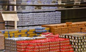 An employee fills an order for shipment at the Anheuser-Busch Sales of Oklahoma distributor in Oklahoma City. About 10 million cases of beer pass through the climate-controlled facility every year. [Photos by Chris Landsberger, The Oklahoman]