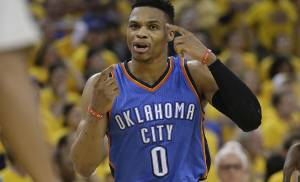 Oklahoma City Thunder guard Russell Westbrook (0) gestures toward an official during the second half of Game 7 of the NBA basketball Western Conference finals against the Golden State Warriors in Oakland, Calif., Monday, May 30, 2016. (AP Photo/Marcio Jose Sanchez)