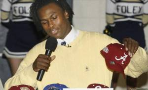 Foley's  Julio  Jones picks up an Alabama hat to announce his college choice during a press conference Wednesday, Feb. 6, 2008 at Foley High School in Foley, Ala.  Jones, one of the nation's top recruits, said Wednesday he will play for University of Alabama. (AP Photo/Press-Register, Chip English)