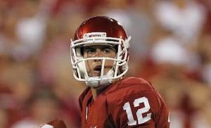 Oklahoma's Landry Jones (12) looks to throw the all during the college football game between the University of Oklahoma Sooners ( OU) and the Tulsa University Hurricanes (TU) at the Gaylord Family-Memorial Stadium on Saturday, Sept. 3, 2011, in Norman, Okla. Photo by Chris Landsberger, The Oklahoman ORG XMIT: KOD