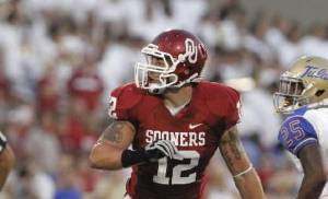 Oklahoma's Tom Wort (12) plays wearing the jersey number of Austin Box during the first half of the college football game between the University of Oklahoma Sooners ( OU) and the Tulsa University Hurricanes (TU) at the Gaylord Family-Memorial Stadium on Saturday, Sept. 3, 2011, in Norman, Okla. Photo by Steve Sisney, The Oklahoman ORG XMIT: KOD