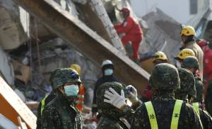 Taiwan rescuers find signs of life in quake rubble