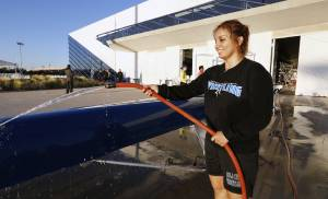Oklahoma City University rower Beatrize Martinez at the Devon Boathouse rinsing off the teams boat after practice in Oklahoma City Friday, Oct. 3, 2014.  Photo by Paul B. Southerland, The Oklahoman