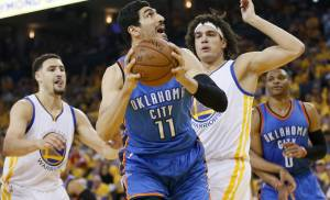 Oklahoma City's Enes Kanter (11) tries to get past Golden State's Anderson Varejao (18) as Klay Thompson (11) watches during Game 5 of the Western Conference finals in the NBA playoffs between the Oklahoma City Thunder and the Golden State Warriors at Oracle Arena in Oakland, Calif., Thursday, May 26, 2016. Photo by Nate Billings, The Oklahoman