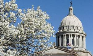 Bradford pear trees in bloom on the  Oklahoma state  Capitol grounds with the  Capitol  dome in the background March 18, 2005, in Okla. City. The vernal equinox marking the first day of  spring is Palm Sunday, March 20, 2005. Staff photo by Paul B. Southerland