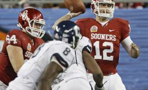 Oklahoma's Landry Jones (12) throws a pass during the Fiesta Bowl college football game between the University of Oklahoma Sooners and the University of Connecticut Huskies in Glendale, Ariz., at the University of Phoenix Stadium on Saturday, Jan. 1, 2011.  Photo by Bryan Terry, The Oklahoman