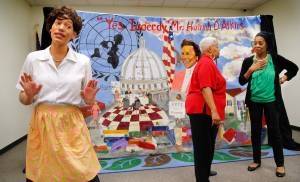 Tierney Palmer, left, portrays Hannah Atkins as a young woman who has just moved with her husband to Oklahoma City. At right are Trena Brown and Sondra McMillon. In celebration of Black History Month, the Metropolitan Library System is presenting more than a dozen performances of Rhythmically Speaking's musical and dramatic tribute to the Oklahoma political leader.  [Photo by Jim Beckel, The Oklahoman]