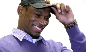 NATIONAL SIGNING DAY / SIGN: Joe Randle adjusts his cap after signing a letter of intent to attend Oklahoma State University (OSU) at Southeast High School in Wichita, Kansas on Wednesday, Feb. 3, 2010. Photo by John Clanton, The Oklahoman