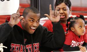 Two Carl Albert High School football players signed letters of intent with colleges during a signing ceremony in the school's fieldhouse, Wednesday morning, Feb, 3, 2010.  Tre Porter gives the Texas Tech Red Raiders'