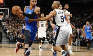 Russell Westbrook drives past Tony Parker in the Thunder's Game 2 victory. (AP Photo)