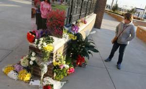 Thunder fan Kathy Medford of Midwest City looks at flowers she and others left in memory of Ingrid Williams, the wife of Oklahoma City Thunder assistant coach Monty Williams, before an NBA basketball game between the New Orleans Pelicans and the Oklahoma City Thunder outside of the Chesapeake Energy Arena in Oklahoma City, Thursday, Feb. 11, 2016. Ingrid Williams died Wednesday evening after being injured in a car crash Tuesday night. Photo by Nate Billings, The Oklahoman