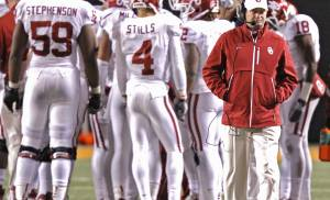 Coach Bob Stoops walks away from the huddle in the fourth quarter of the Sooners' 44-10 loss to OSU during the Bedlam college football game between the Oklahoma State University Cowboys (OSU) and the University of Oklahoma Sooners (OU) at Boone Pickens Stadium in Stillwater, Okla., Saturday, Dec. 3, 2011. Photo by Chris Landsberger, The Oklahoman