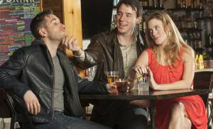 Glenn (Mateja Govich, center) tries to persuade his roommate Henry (Zachary Prince) to take Christine (Liz Shivener) on a date in this scene from