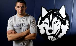Edmond North wrestling coach Andy Schneider poses for a portrait inside the high school's wrestling room in Edmond, Okla., Wednesday, Feb. 10, 2016. Photo by Bryan Terry, The Oklahoman