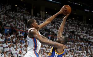 Oklahoma City's Kevin Durant (35) blocks the shot of Golden State's Draymond Green (23) during Game 4 of the Western Conference finals in the NBA playoffs between the Oklahoma City Thunder and the Golden State Warriors at Chesapeake Energy Arena in Oklahoma City, Tuesday, May 24, 2016. Oklahoma City won 133-105. Oklahoma City won 118-94.  Photo by Bryan Terry, The Oklahoman