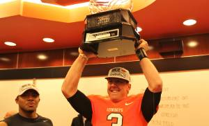 Oklahoma State quarterback Brandon Weeden celebrates with the Big 12 Championship trophy. PHOTO COURTESY OSU SPORTS INFORMATION