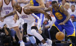 Oklahoma City's Serge Ibaka (9) goes for the ball beside Golden State's Draymond Green (23) during Game 4 of the Western Conference finals in the NBA playoffs between the Oklahoma City Thunder and the Golden State Warriors at Chesapeake Energy Arena in Oklahoma City, Tuesday, May 24, 2016. Oklahoma City won 133-105. Oklahoma City won 118-94.  Photo by Bryan Terry, The Oklahoman