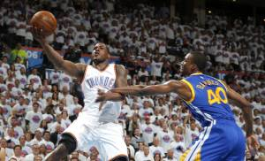 Oklahoma City's Dion Waiters (3) goes past Golden State's Harrison Barnes (40) during Game 4 of the Western Conference finals in the NBA playoffs between the Oklahoma City Thunder and the Golden State Warriors at Chesapeake Energy Arena in Oklahoma City, Tuesday, May 24, 2016. Oklahoma City won 133-105. Photo by Bryan Terry, The Oklahoman