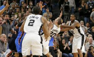 Oklahoma City's Dion Waiters (3) throws the ball in as San Antonio's Manu Ginobili (20) falls back late in Game 2 of the second-round series between the Oklahoma City Thunder and the San Antonio Spurs in the NBA playoffs at the AT&T Center in San Antonio, Monday, May 2, 2016. Oklahoma City won 98-97. Photo by Bryan Terry, The Oklahoman