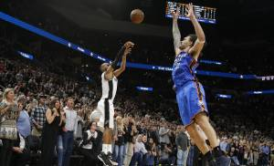 San Antonio's Patty Mills (8) shoots over Oklahoma City's Steven Adams (12) in the last seconds of Game 2 in the second-round series between the Oklahoma City Thunder and the San Antonio Spurs in the NBA playoffs at the AT&T Center in San Antonio, Monday, May 2, 2016. Oklahoma City won 98-97. Photo by Bryan Terry, The Oklahoman