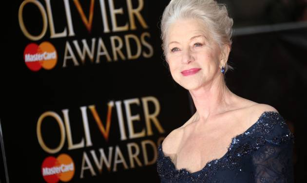 Helen Mirren poses on arrival at the Olivier Awards 2013 at the Royal opera House in London on Sunday, April 28, 2013. (Photo by Joel Ryan/Invision/AP)