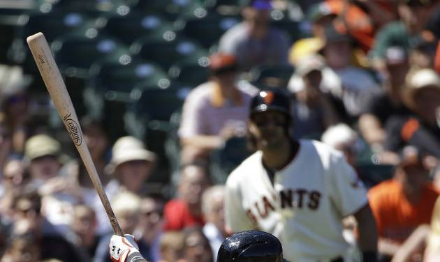 San Francisco Giants' Buster Posey strikes out swinging against Oakland Athletics relief pitcher Dan Otero in the eighth inning of their interleague baseball game Thursday, July 10, 2014, in San Francisco. (AP Photo/Eric Risberg)