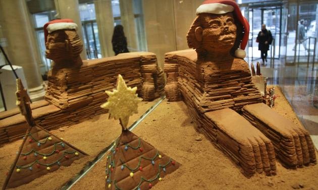 "This Nov. 30, 2012 photo shows""The Sphinx,"" a gingerbread creation from North End Grill, on display in the lobby area of Le Parker Meridien hotel in New York.  The landmark-inspired creation is being exhibited with other over-the-top gingerbread houses from city restaurants in the annual display to benefit City Harvest, a food rescue organization for feeding the needy.  (AP Photo/Bebeto Matthews)"