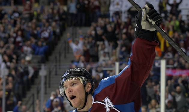 Colorado Avalanche center Paul Stastny celebrates a goal against Phoenix Coyotes goalie Thomas Greiss during the third period of an NHL hockey game on Friday, Feb. 28, 2014, in Denver. (AP Photo/Jack Dempsey)
