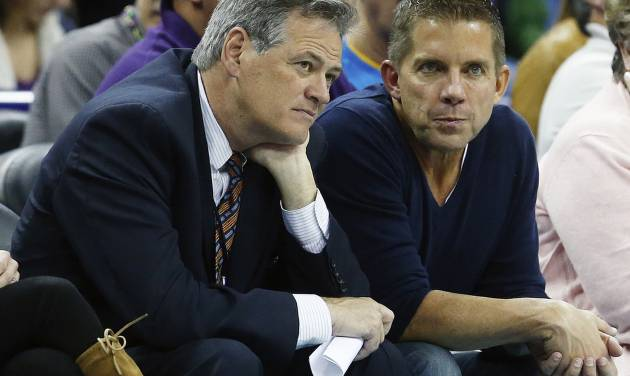 Mickey Loomis, executive vice president/general manager of the New Orleans Saints, talks with Saints head coach Sean Payton, right, in the first half of an NBA basketball game between the New Orleans Hornets and the Phoenix Suns in New Orleans, Wednesday, Feb. 6, 2013. (AP Photo/Bill Haber)