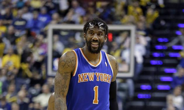 New York Knicks forward Amare Stoudemire walks off the court after being shaken up on a foul by the Indiana Pacers during the second half of an NBA basketball game in Indianapolis, Thursday, Jan. 16, 2014. The Pacers defeated the Knicks 117-89. (AP Photo/Michael Conroy)