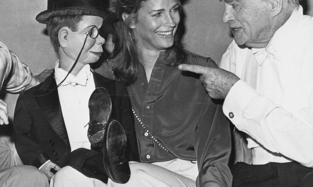 """FILE - This Sept. 30, 1978 file photo shows dummy Charlie McCarthy crossing his legs on the lap of actress Candice Bergen as her father, ventriloquist Edgar Bergen, points at Caesar's Palace Hotel in Las Vegas at Edgar Bergen's farewell performance before his intended retirement.  He died in his sleep later that night. A spokeswoman for Candice Bergen says the actress is developing a film about her late father. Spokeswoman Heidi Schaeffer said Tuesday, April 30, 2013, that the big-screen project will be based on Candice Bergen's 1984 memoir, """"Knock Wood.""""  (AP Photo, file)"""
