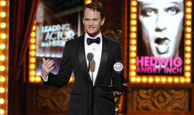 """Neil Patrick Harris accepts the award for best performance by an actor in a leading role in a musical for """"Hedwig and the Angry Inch"""" on stage at the 68th annual Tony Awards at Radio City Music Hall on Sunday, June 8, 2014, in New York. (Photo by Evan Agostini/Invision/AP)"""