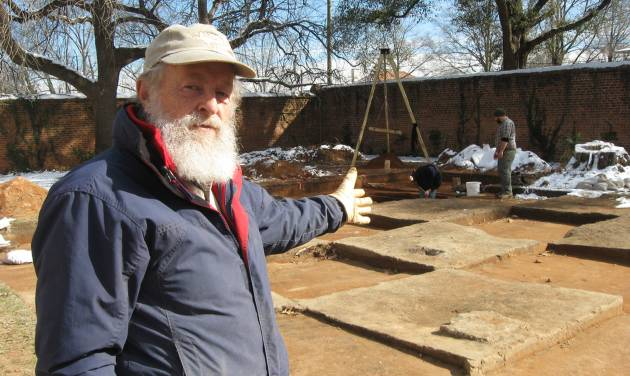 "In this Jan. 30, 2014 photo, University of South Carolina research archaeologist Chester DePratter stands by the archaeological dig of ""Camp Asylum,"" the Civil War-era prison that once held 1,500 Union officers on the grounds of the state mental hospital in Columbia, S.C., in the waning days of the Civil War. Racing against time, South Carolina archeologists are digging to uncover the remnants of a Civil War-era prisoner-of-war camp before the site in downtown Columbia is cleared to make room for a mixed-use development.  (AP Photo/Susanne Schafer)"