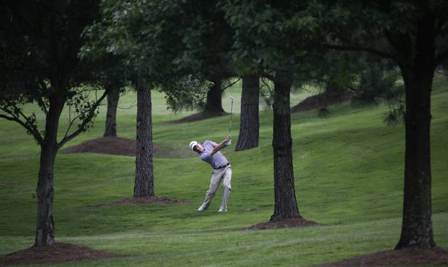Peter Malnati hits an approach shot on the 6th hole during the first round of the St. Jude Classic golf tournament Thursday, June 5, 2014, in Memphis, Tenn. Malnati took a par on the hole. (AP Photo/Mark Humphrey)