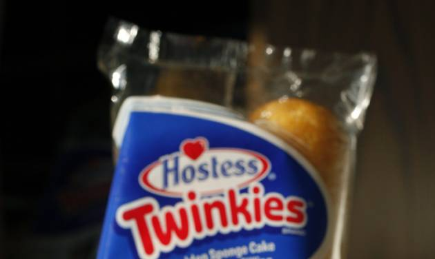 FILE - This Tuesday, Jan. 10, 2012, file photo, shows, Hostess Twinkies in a studio in New York. Hostess Brands Inc. announced Thursday, Nov. 15, 2012, that it is warning striking employees that it will move to liquidate the company if plant operations don't return to normal levels by Thursday evening. The maker of Twinkies, Ding Dongs and Wonder Bread said Thursday it will file a motion in U.S. Bankruptcy Court to shutter operations if enough workers don't return by 5 p.m. EST. That would result in the loss of about 18,000 jobs.( AP Photo/Mark Lennihan)