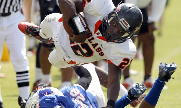 Douglass' Chris High leaps over Millwood's Alfonso McMillan during the high school football game between Millwood and Douglass at Millwood High School in Oklahoma City, Saturday, Sept. 10, 2011. Photo by Sarah Phipps, The Oklahoman  ORG XMIT: KOD