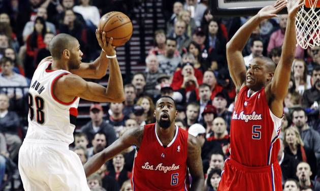Portland Trail Blazers forward Nicolas Batum, left, of France, passes off as Los Angeles Clippers' DeAndre Jordan (6) and Caron Butler (5) defend during the first quarter of their NBA basketball game in Portland, Ore., Thursday, Nov. 8, 2012. (AP Photo/Don Ryan)