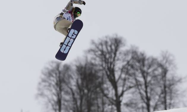Jamie Anderson of the United States takes a jump on her final run in the women's snowboard slopestyle final at the 2014 Winter Olympics, Sunday, Feb. 9, 2014, in Krasnaya Polyana, Russia.  (AP Photo/Andy Wong)